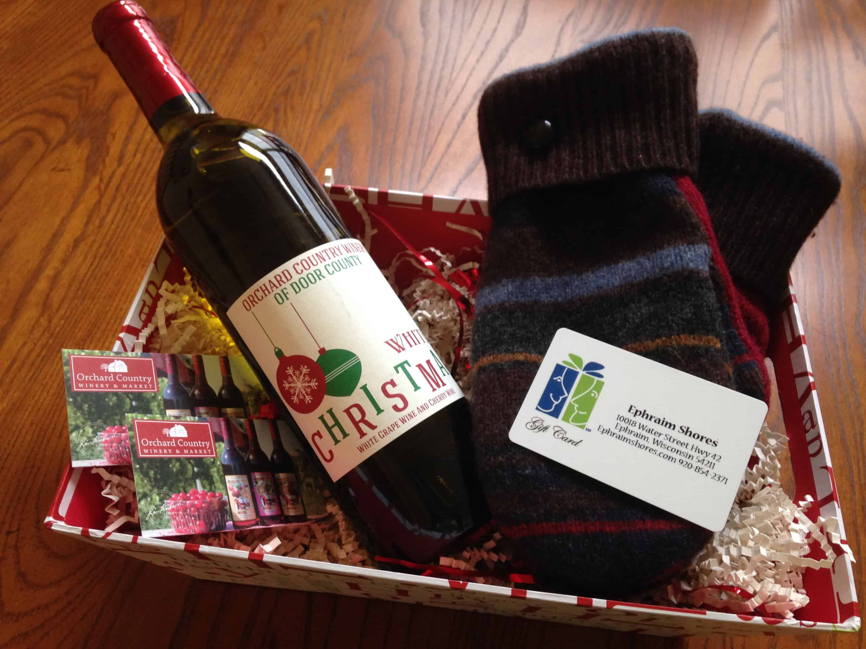 A gift basket will include two wine tour tickets, a $25 gift card for Ephraim Shores, White Christmas wine and wool mittens.